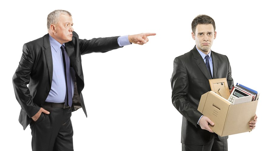 Angry boss firing a man with box of personal items