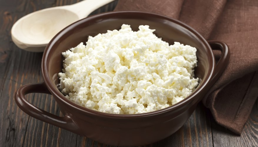 Cottage cheese in a brown bowl
