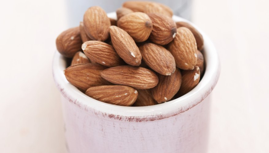 24 almonds provides approximately 3.3 grams of fiber; English walnut halves, about 1.9