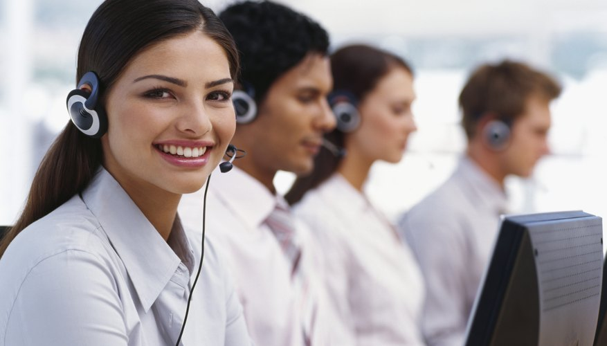 side profile of four business executives wearing headsets in an office