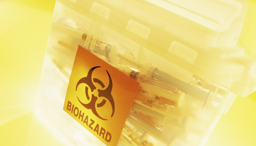 Syringes in a Bin for Biohazard Waste