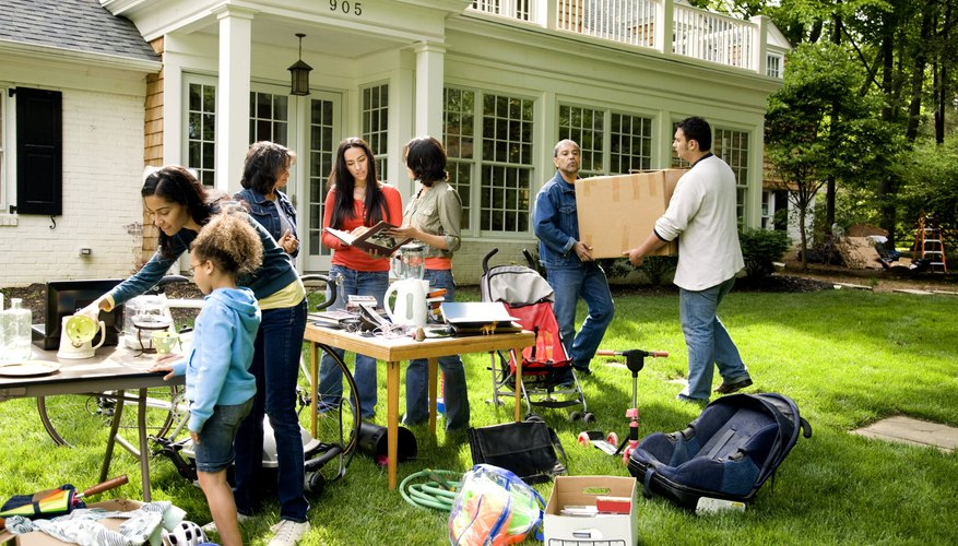 Hold a yard sale to eliminate items that won't fit in your condo.