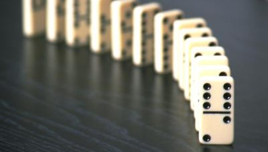 Play a game of Super Dominoes with a set of Double 15 dominoes.
