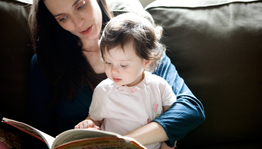 Toddlers love to listen to stories and look at pictures.