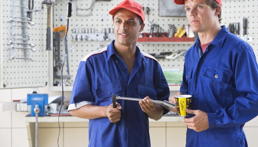 Mechanics standing in garage