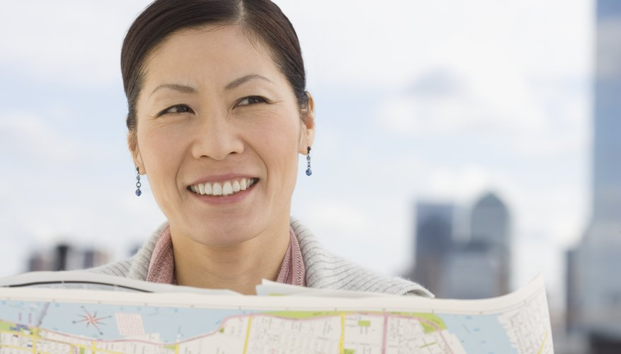 Woman holding up map