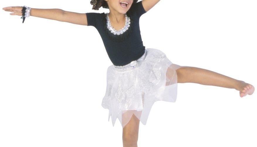 Preschool children learn to express themselves through dance.
