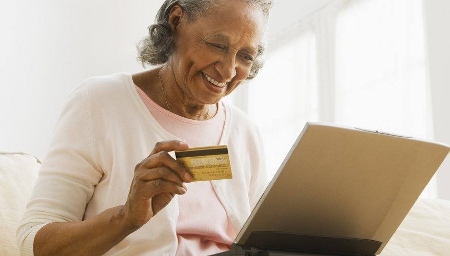 Senior African woman online shopping