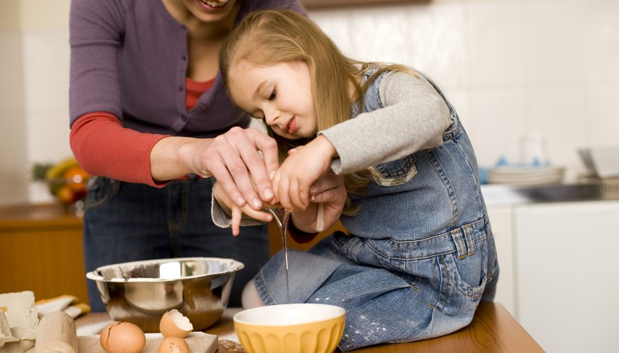 Cooking with a young girl
