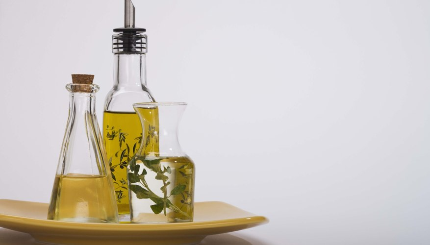 Several types of olive oil in bottles.
