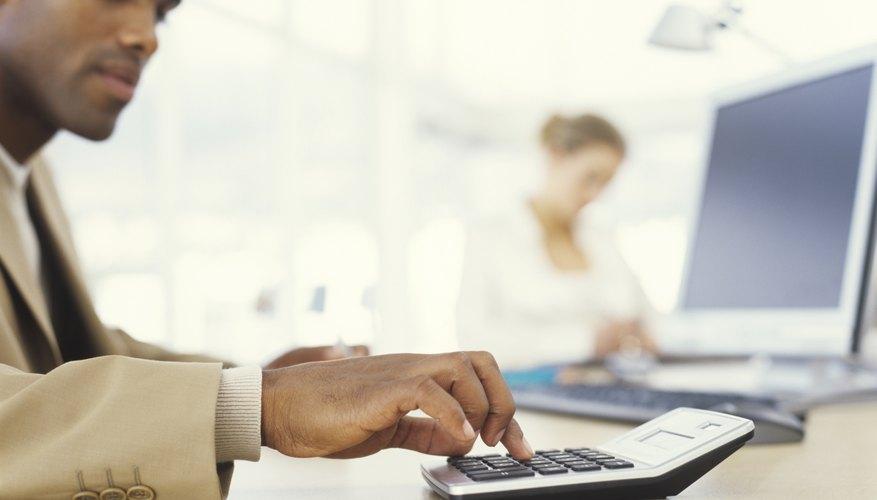 Businessman using calculator, close up