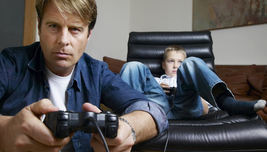 Father and son about to play video game