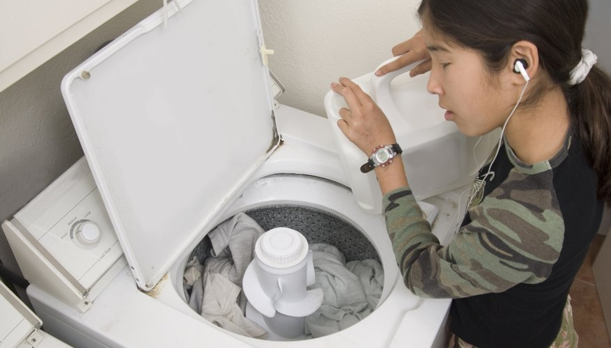 Teenager doing laundry.