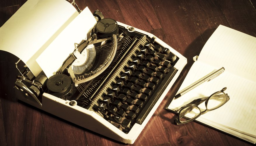 Typewriter with book and eyeglasses