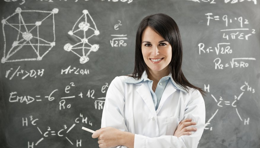Scientist in front of her chalkboard