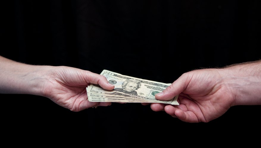 Man hands woman money