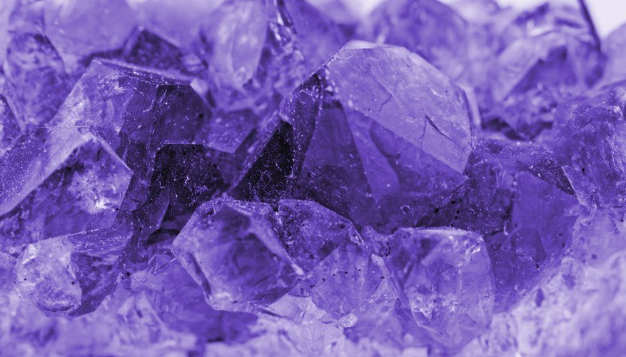 Crystals are formed by evaporation or pressure exerting forces on minerals.