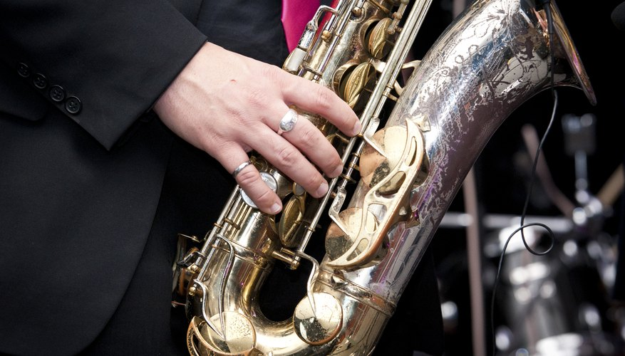 A close-up of a man playing the saxophone on a stage.