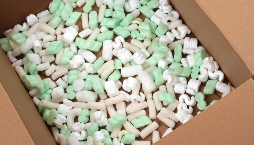 Opened cardboard box filled with polystyrene foam peanuts.