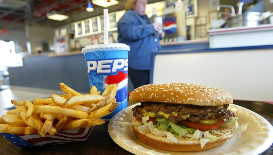 Double cheeseburger, french fries and a Pepsi drink