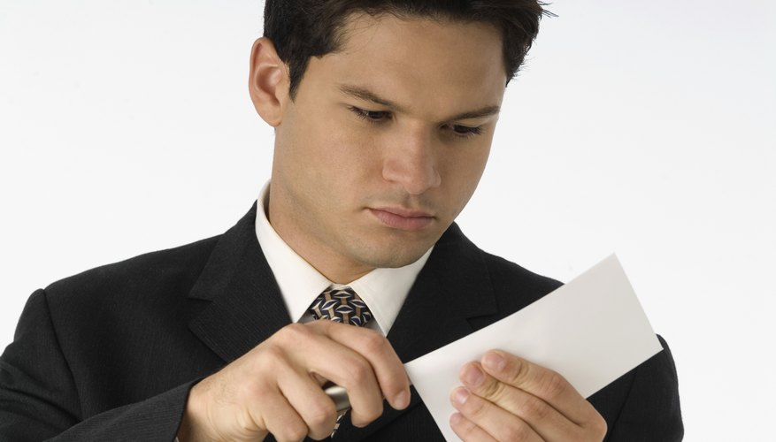 Businessman opening letter with letter opener, close-up