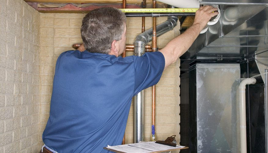 Handyman inspecting pipes