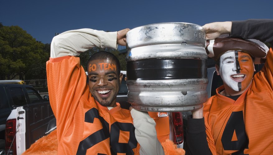 Men carrying a beer keg at football game