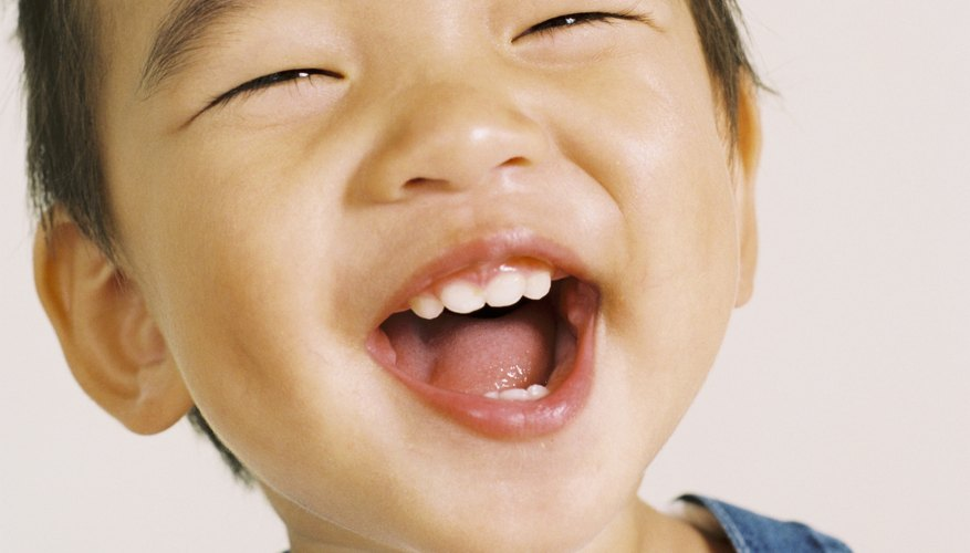 Protect toddler teeth by helping him quit chewing on his clothes.