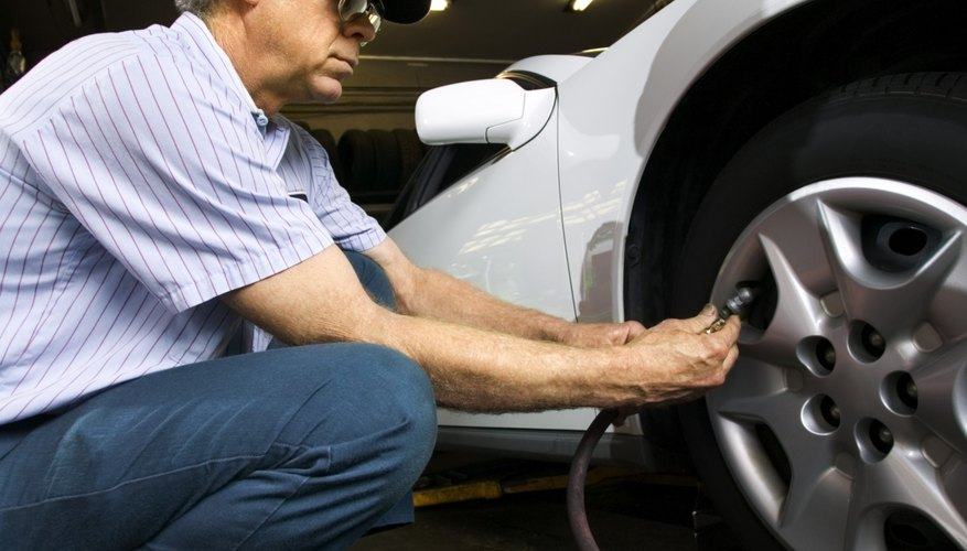 Mechanic inflating car tire