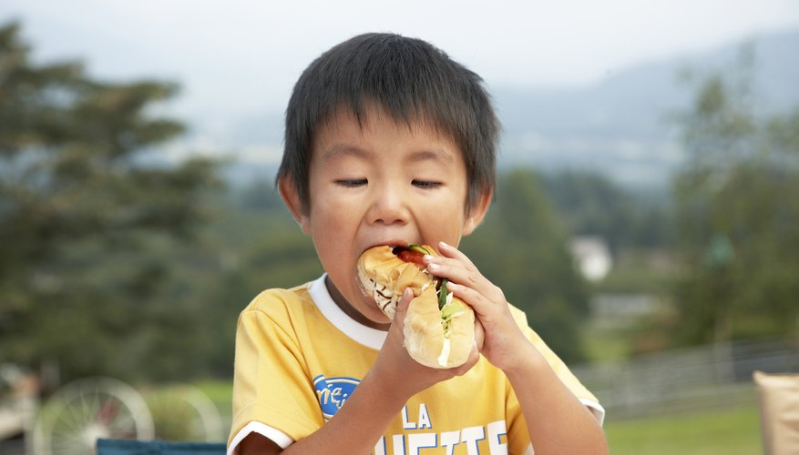 Caution your child to take small bites to avoid mouth injuries.