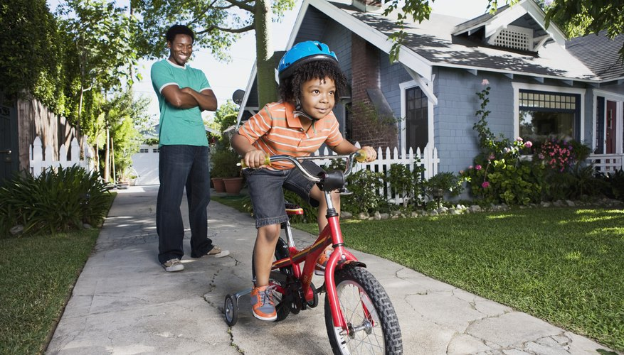 Children need training wheels at first but as balance improves they lose the training wheels around age 8.