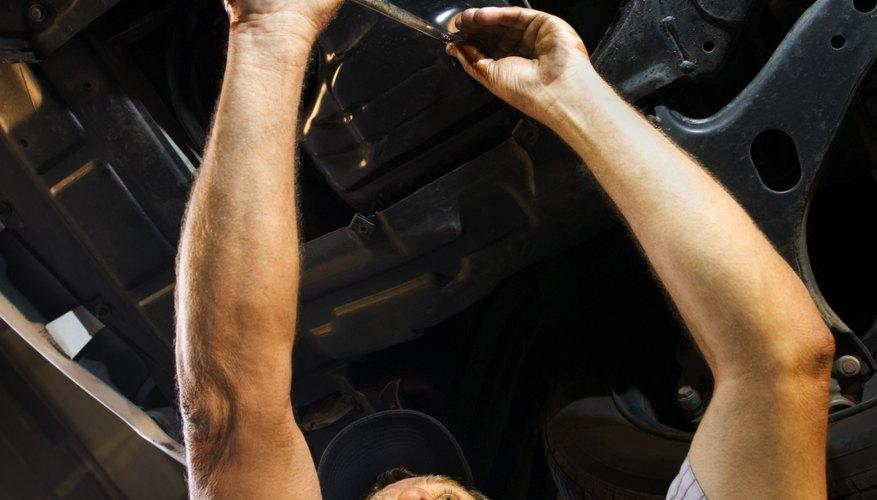 Mechanic working under car on lift