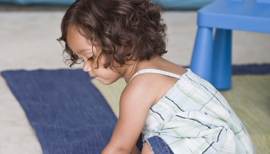 Rolling a ball helps your toddler learn to coordinate her hands and eyes as she tracks its movement.