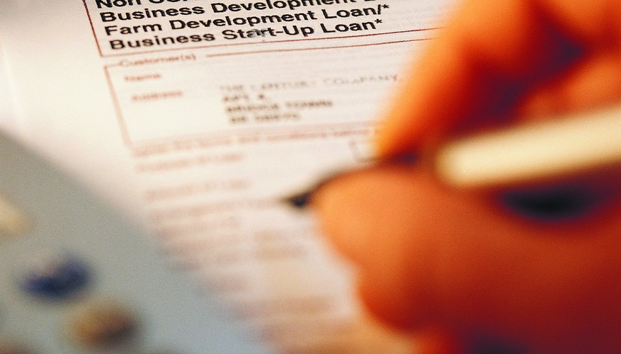 Person filling out loan application