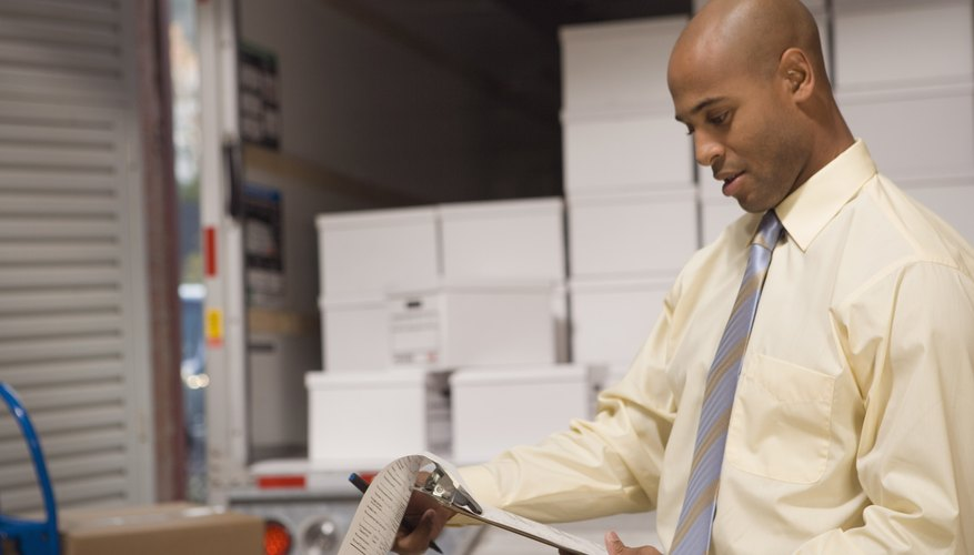 Man looking at inventory of delivery