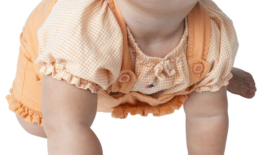 Baby spit-up can lead to a closet full of stained clothing.