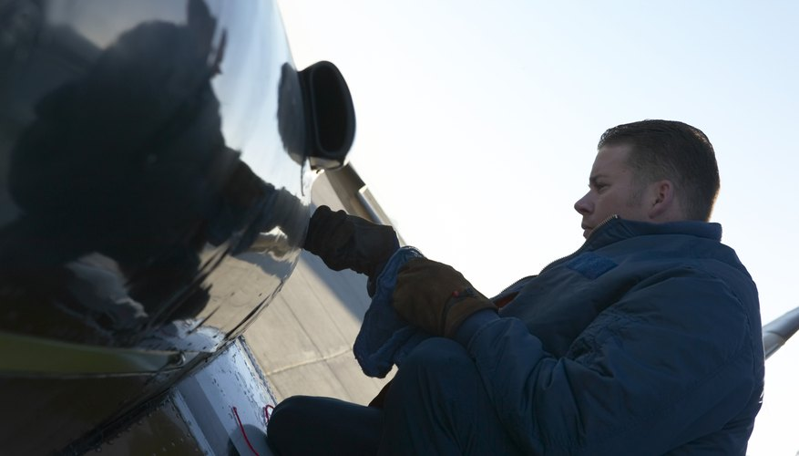 Mechanic refueling airplane