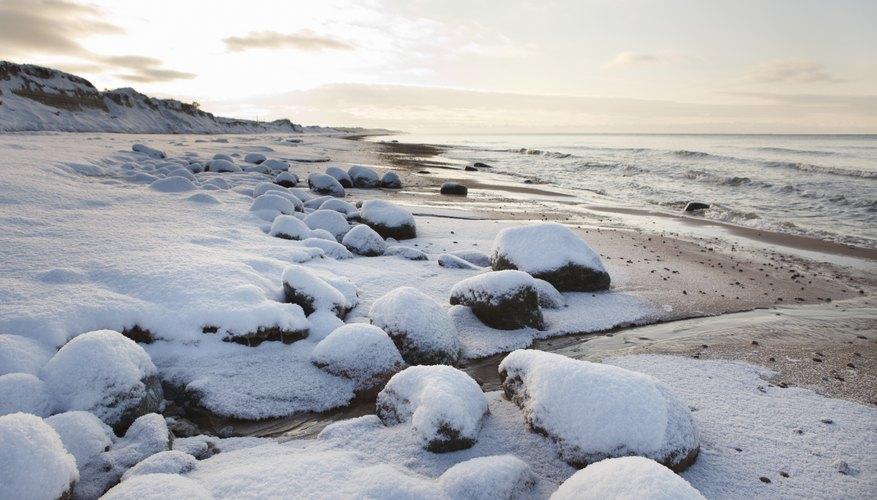 Snow and ice on rocks along the beach.