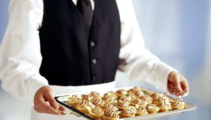 Waiter with tray of food for catered event.
