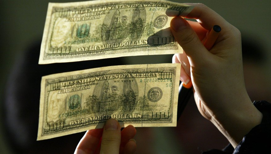 Examinar dinero real y falso