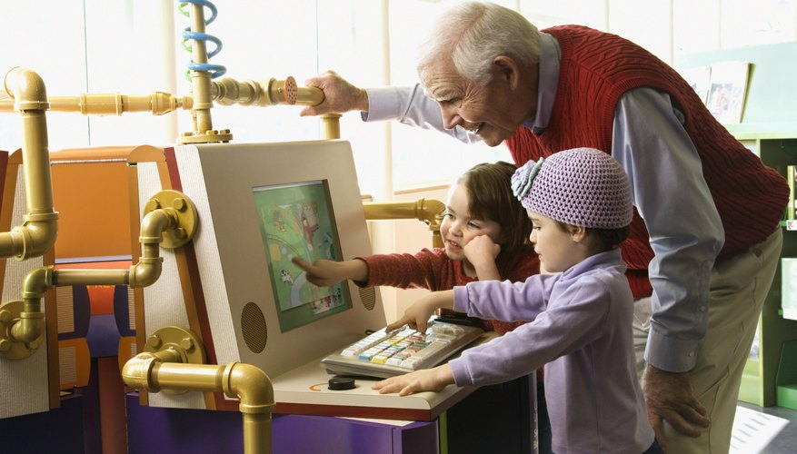 Grandfather with grandchildren in library