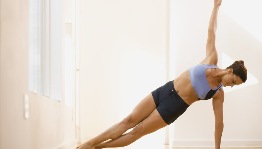Roll to the outer edges of the feet and lift the hips for Side Plank.