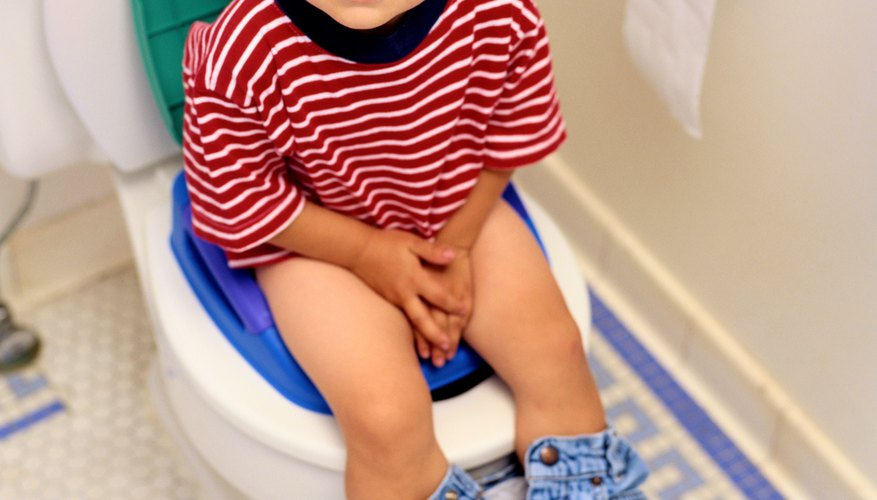 It can take several more months before he'll poop in the potty.