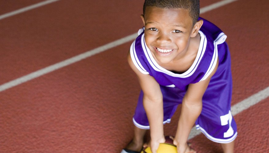 Play games with your 4-year-old to teach him the fundamentals of the game.