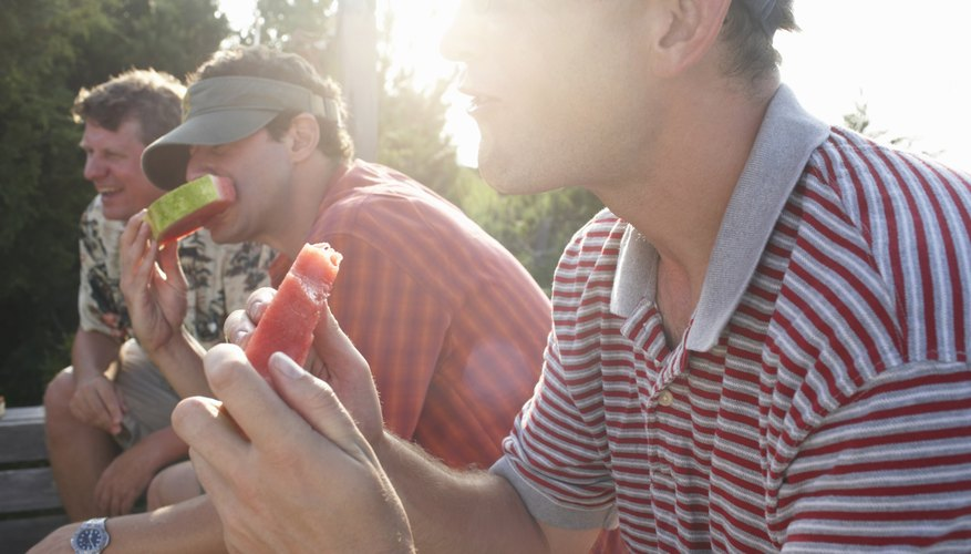 Friends eating watermelon at the end of a summer day.