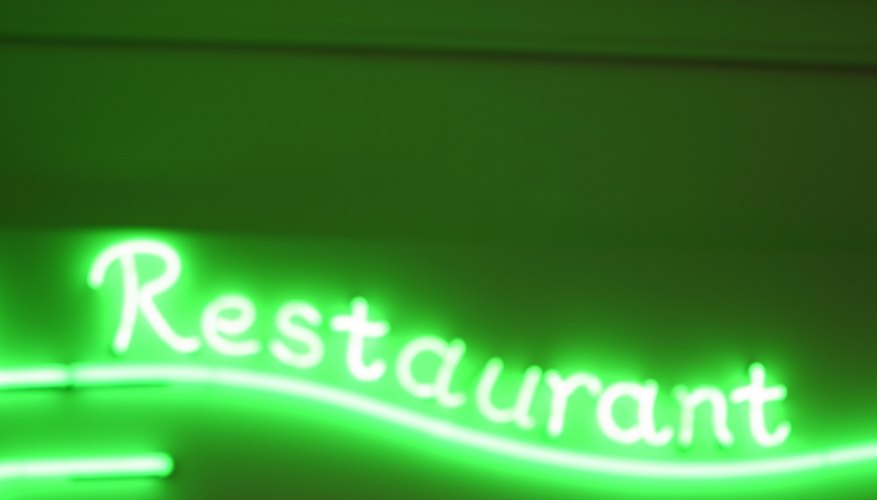 Neon gas gives off a bright glow in signs and displays.