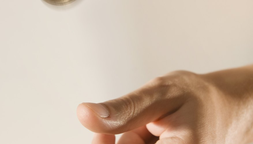 Hand flipping coin