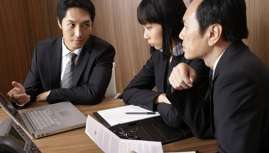 Business people in meeting around table in conference room