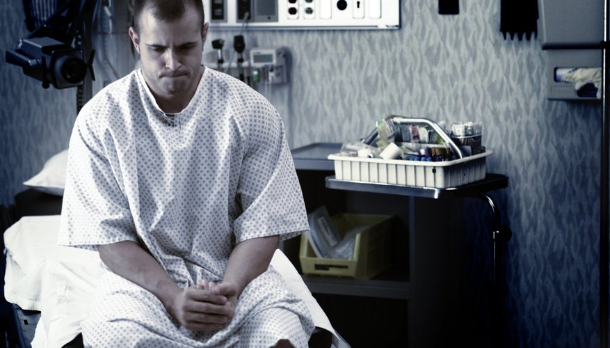 lifestyle photo of a young caucasian man as he waits in a hospital examination room