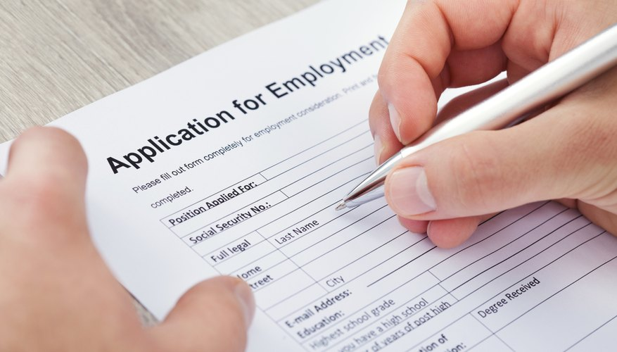 A man is filling out an application for employment.